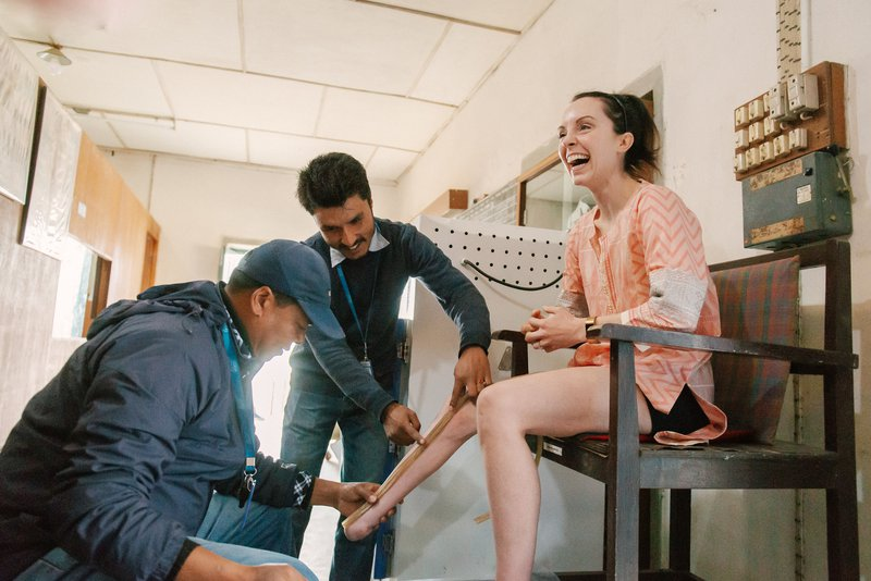 Stef Reid is fitted for her prosthetic at the workshop at Anandaban Hospital