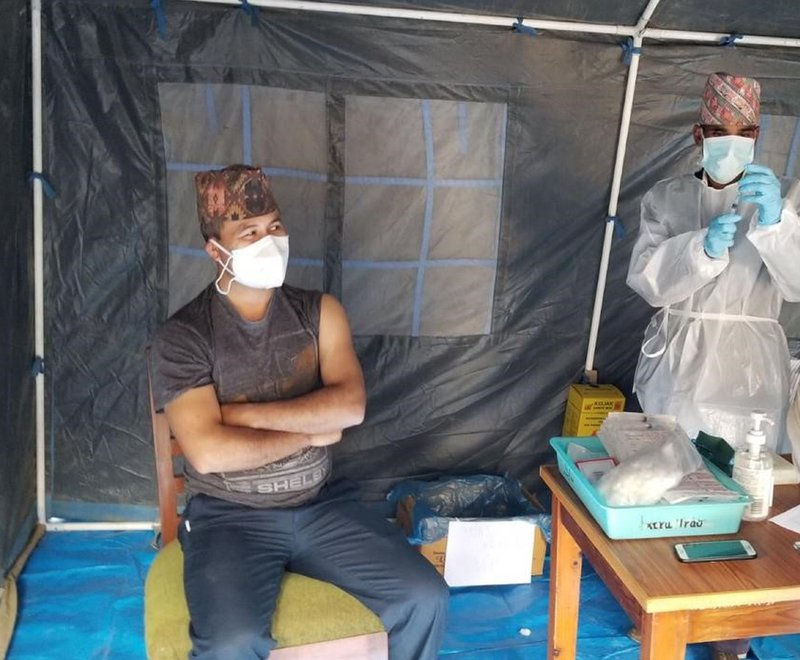 Dr Pradip Sapkota, Medical Superintendent at Anandaban Hospital in Nepal, is given the first dose of the Oxford Covid-19 vaccine