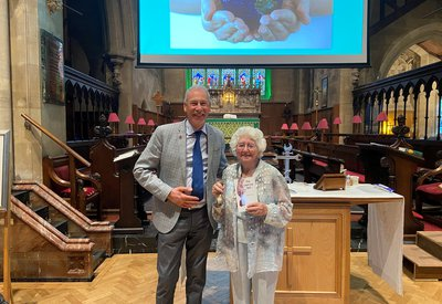 Margaret Williams  with Trevor Grant, Community Partnerships Manager at The Leprosy Mission, at her 90th birthday celebrations and launch of her first novel The Leprosy Bell at Christ Church, Swindon.jpg