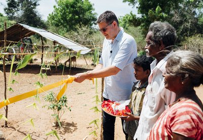 Peter Waddup opens a new well for a family affected by leprosy in Sri Lanka.jpg
