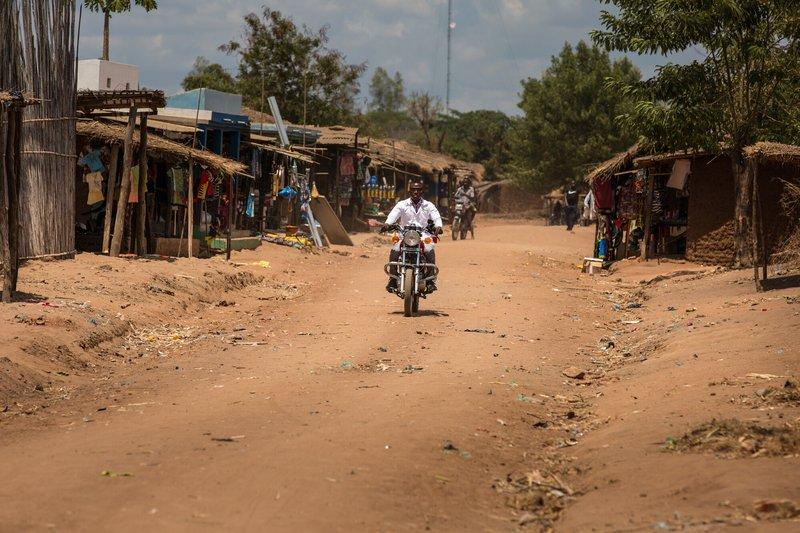 Gabriel, a health worker in Mozambique, travels around by motorbike.