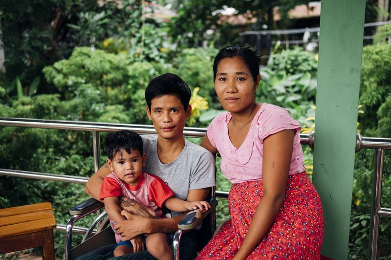 Phyo, a patient at Mawlamyine Hospital in Myanmar, and his family.