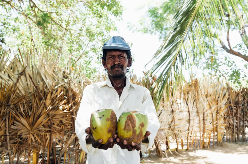 Kunam with his coconuts