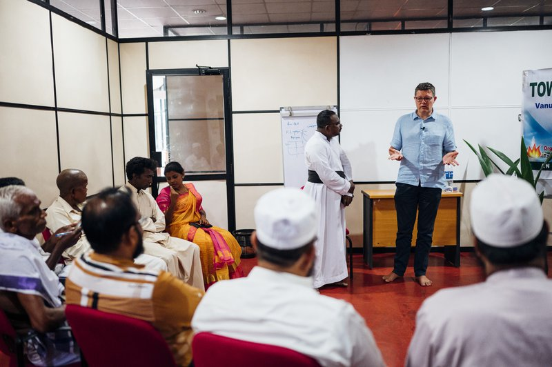 Peter Waddup speaks at an interfaith event in Sri Lanka in 2019.